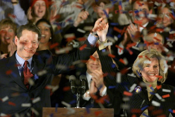 Democratic presidential candidate Vice President  Al Gore has his arm raised in triumph by wife Tipp..