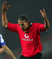 Manchester United's Ferdinand reacts after he is given a red card in Blackburn
