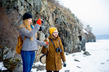 Couple hiking on a mountain lake