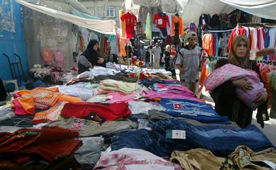 Palestinians shop inside a market in Rafah