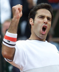 ALEX CORRETJA OF SPAIN REACTS AT THE FRENCH TENNIS OPEN.