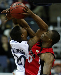 Xavier Musketeers Anderson is fouled by Georgia Bulldogs Woodbury during NCAA men's basketball tournament game in Washington