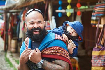 Man with kid in Peru market
