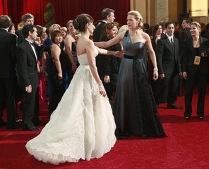 Nominees Kate Winslet and Penelope Cruz meet on red carpet at 81st Academy Awards in Hollywood