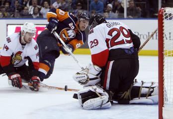 New York Islanders Bergenheim goes down as Ottawa Senators Gerber makes save in Uniondale