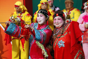 Performers wear traditional clothes during a temple fair celebrating Chinese New Year in Beijing