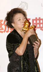 Mei Fang kisses her award for best supporting actress at the 45th Golden Horse Awards in Taichung