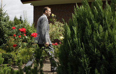 File picture shows Thuringia's State Prime Minister Dieter Althaus of the Christian Democratic Union (CDU) walking alone through his garden after casting their votes for the state elections in Heiligenstadt