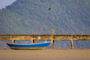 Image of small boat sitting on the beach.