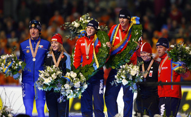Medallists pose during the prize winning ceremony of the World Allround Speed Skating Championships at the Thialf stadium in Heerenveen