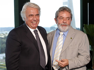 Brazil's President  Lula da Silva and  de la Sota, Governor of the Argentine province of Cordoba, pose before  their meeting in Brasilia
