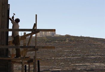 Labourer works on a construction site in Jewish settlement of Givat Zeev