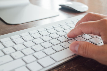 Close up Single finger press button on laptop keyboard