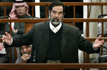Former Iraqi President Saddam Hussein speaks at his trial in Baghdad March 1, 2006. The chief prosec..