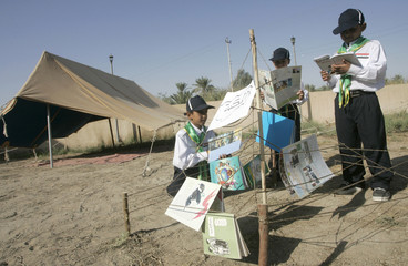 Scouts read books in Baghdad
