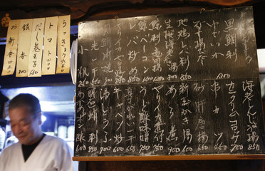 "Today's menu, written on the blackboard, is displayed at a traditional Japanese ""Izakaya"" pub called Saiki in Tokyo"
