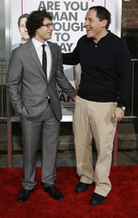 Jon Favreau smiles with Andy Samberg at the premiere of the movie I Love You, Man at the Mann's Village theatre in Los Angeles