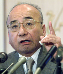 CONTROVERSIAL HISTORY TEXTBOOK AUTHOR GROUP CHAIRMAN KANJI NISHIOSPEAKS TO REPORTERS IN TOKYO.