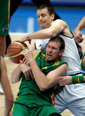 Italy's Rocca (background) steals the ball from Lithuania's Songaila during their match at the second round of the world basketball championships in Saitama