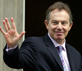 Britain's Prime Minister Tony Blair waves goodbye to his French counterpart [Jean Pierre Rafarin], f..