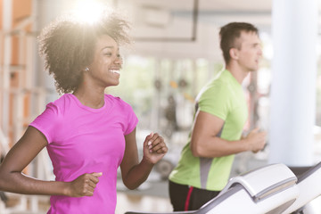 people exercisinng a cardio on treadmill