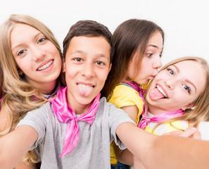 teenage boy making selfie with cute funny girls