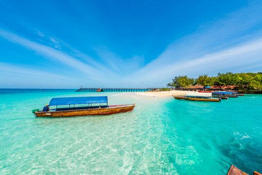 colorful exotic seascape with boats near Zanzibar shore in Africa