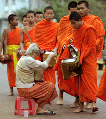 Buddhists monks in the Lao capital of Vientiane receive offerings ahead of 10th ASEAN summit.