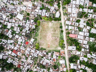 poor fishing village on Zanzibar island with football field, top view, aerial photo