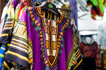 beautiful colorful traditional clothes with patterns at african market
