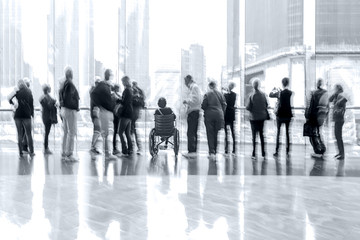 group of people in the lobby business center in monochrome blue tonality