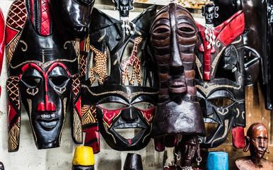 variety of african tribal handmade masks at souvenir market