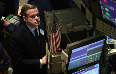 Man looks at computer screen on the floor of the New York Stock Exchange in New York