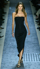 MODEL WALKS RUNWAY IN FASHIONS FROM JOHN VARVATOS FALL/WINTER 2004 COLLECTION.