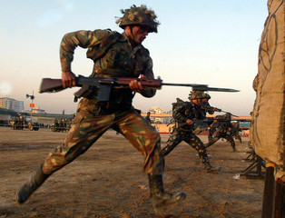 """Indian soldiers practice during rehearsal at the """"Know your Army"""" exhibition in the western Indian city of Ahmedabad"""