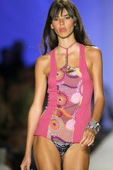 Model shows swimwear outfit from the collection of Italian designer Miss Bikini during Mercedes-Benz Fashion Week show in Miami Beach