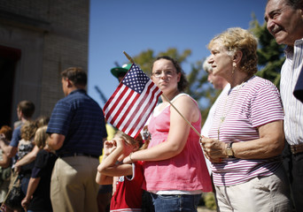 Supporters wait for US Republican presidential candidate McCain as he campaigns at a fire station in Philadelphia