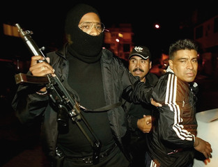 POLICE ARREST A MAN IN MEXICO CITY.