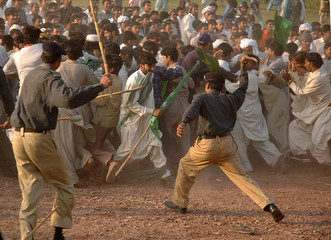 Pakistani police disperse supporters of ruling Pakistan Muslim League party at end of rally in Lahore