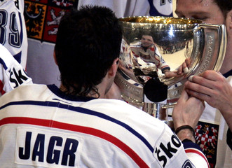 Jagr of the Czech Republic holds the trophy after the final of the Ice Hockey World Championships ...