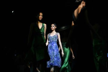 Models display creations by Carolina Herrera during the Dominicana Moda fashion week 2009 in Santo Domingo