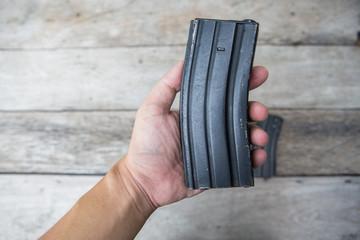 Magazines gun in hand