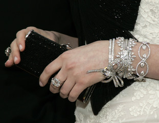 Anne Hathaway's jewellry and handbag are seen on the red carpet at the 79th Annual Academy Awards in Hollywood