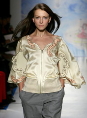 A model presents a creation by Japanese designer Tsumori Chisato during the presentation of her Spri..