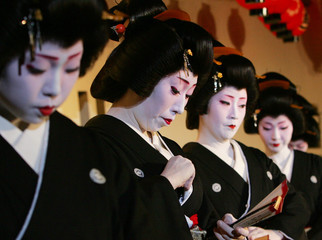 Geiko perform during the Gion Odori appearance in Kyoto, Japan