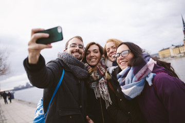 Groups of friends taking a photo selfie.