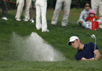 Martim Kaymer of Germany plays from the bunker on the 15th hole during the 2009 HSBC Champions golf tournament in Shanghai