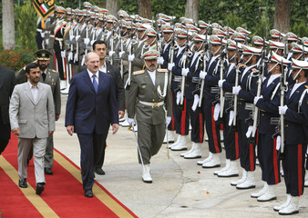 Belarusian President Lukashenko walks with his Iranian counterpart Ahmadinejad in Tehran