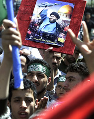 PALESTINIANS PROTESTERS HOLD POSTER OF SHEIKH NASRALLAH DURING RALLY ATYARMOUK CAMP.