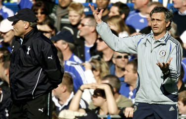 Chelsea's Mourinho reacts beside Tottenham Hotspur's Jol during their FA Cup quarter-final soccer match in London